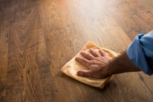 A person cleaning wooden floors.