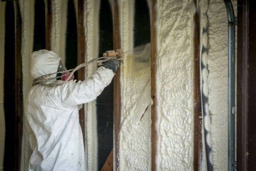 A person insulating a home.