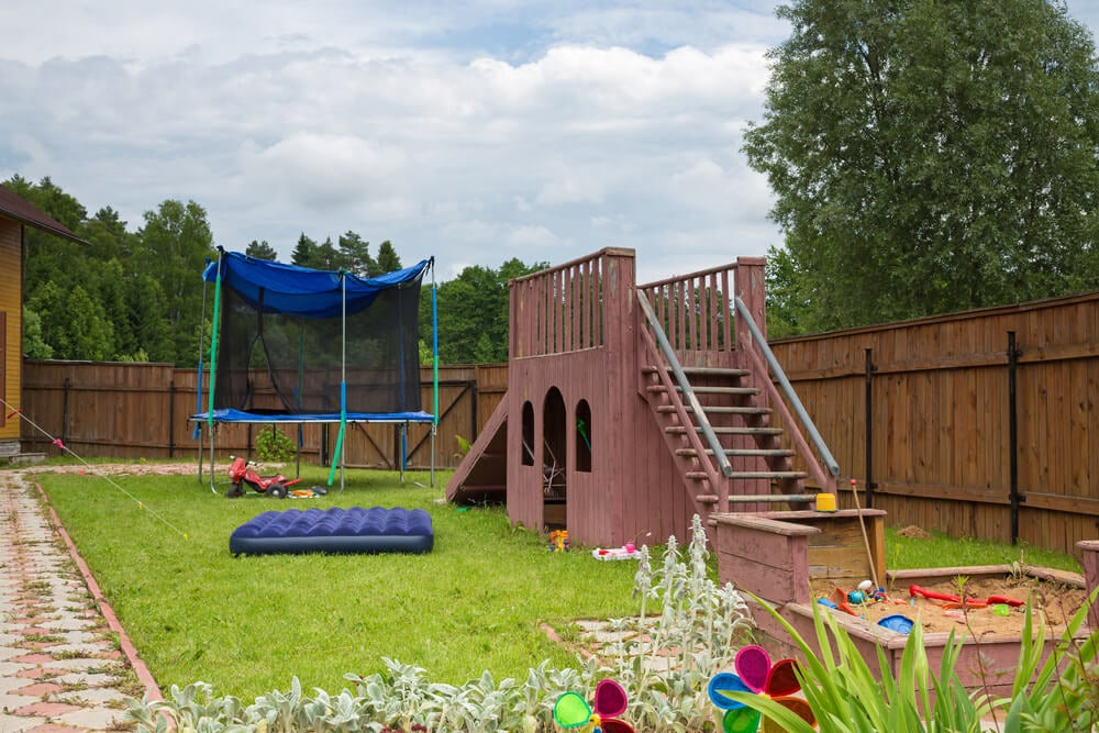 Install a playground in your backyard for your children.