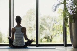 A woman meditating.