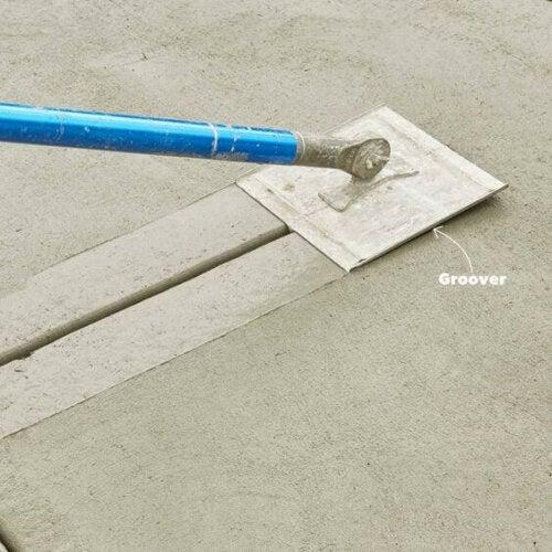 A person smoothing a concrete platform.