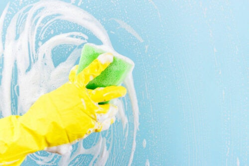 A person cleaning with a sponge.