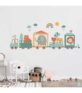 A decorative vinly of a train in a baby's room.