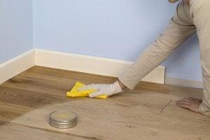 person polishing a wood floor