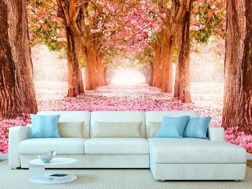 A couch in front of a photo mural.