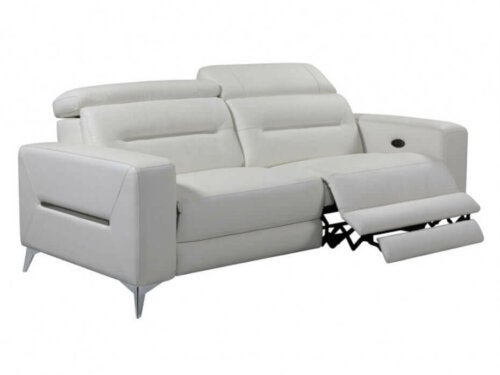 A couch with a footrest.