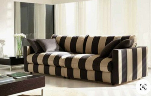 A large sofa in a living room.