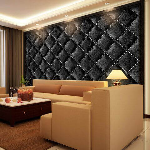 A living room with a padded wall.