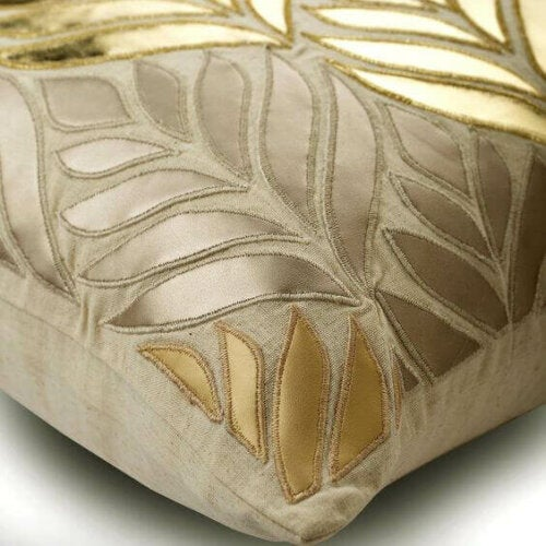 A pillow with some golden engravings.