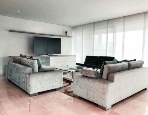 A very modern living room with a large television.