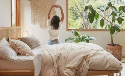 A woman stretching on her bed.