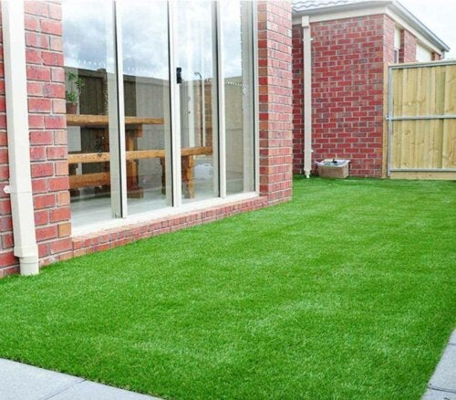 An outdoor lawn with artificial grass.