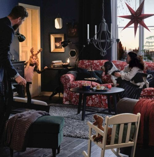 A family in the living room for the holidays.