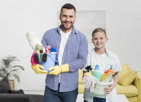 Father and son with cleaning materials to detox your house