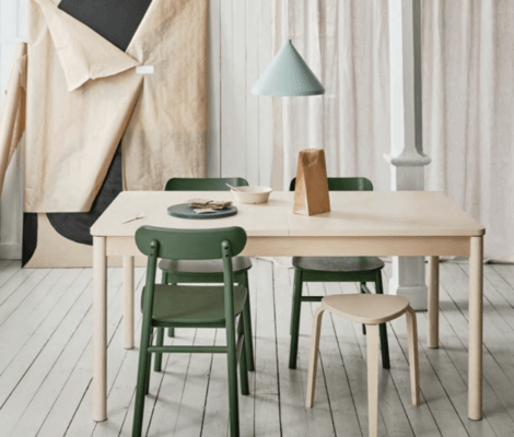 A small dining room with a small table