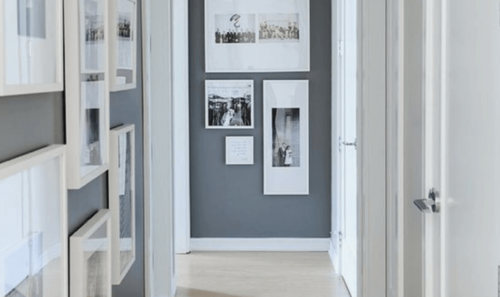 Gray wall with pictures on the wall