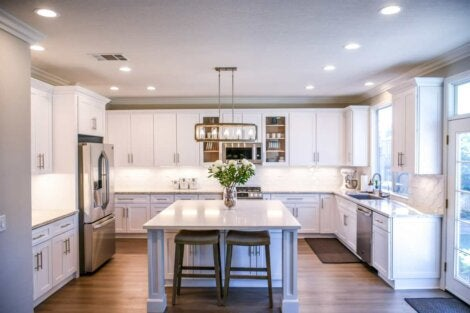 Open kitchen with white walls and bright lights