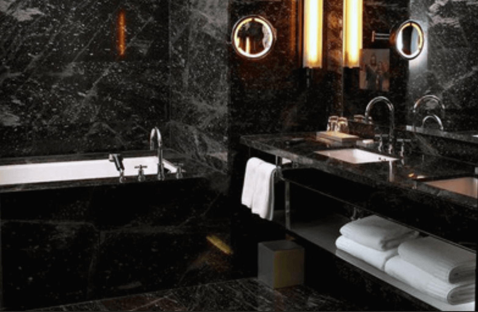 black marble bathroom with white towels