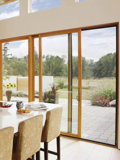 A dining room with folding doors.