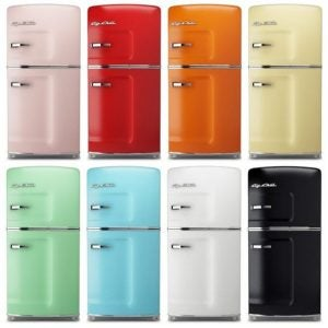 Several refrigerators in various bright colors. Are they retro, vintage, antique?