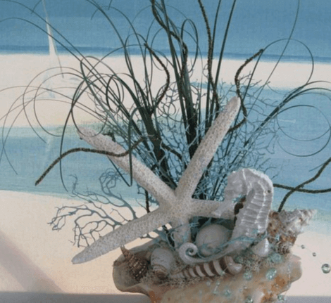 an arrangement with a sea plant to illustrate starfish motif