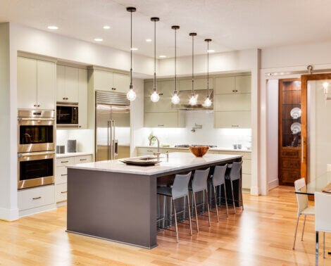 Kitchen with an island and highly illuminated