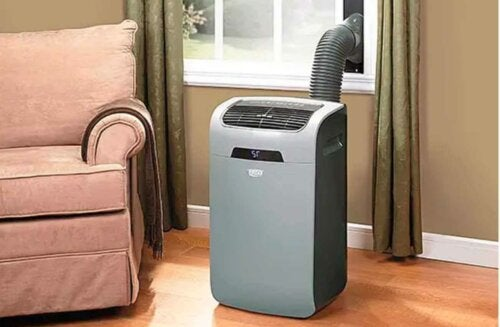 A portable air conditioner in a living room.