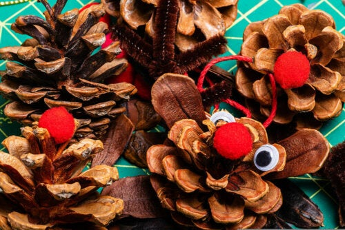 Some reindeer made from pinecones are some DIY Christmas decorations.