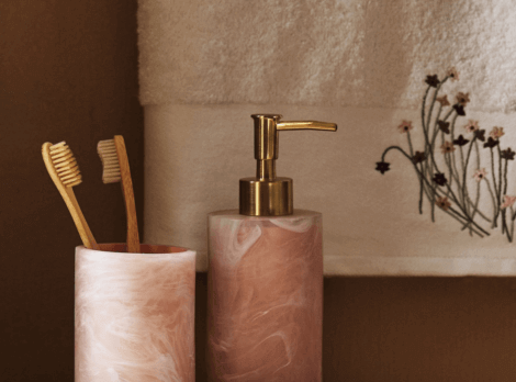 Toothbrush holder and soap dispenser in a modern bathroom