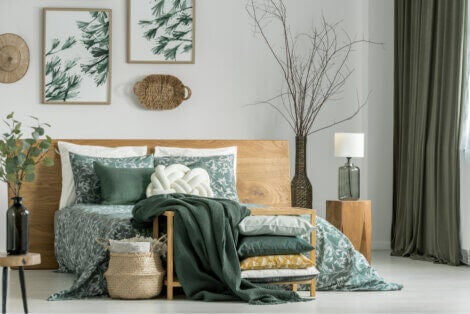 A bedroom decorated in green and natural wood