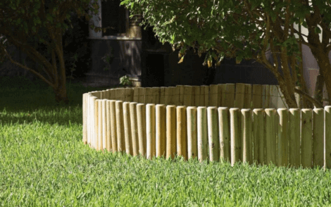 Yard border around a tree composed of posts.