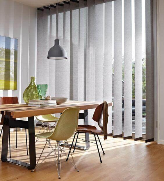 Vertical shutter blinds.