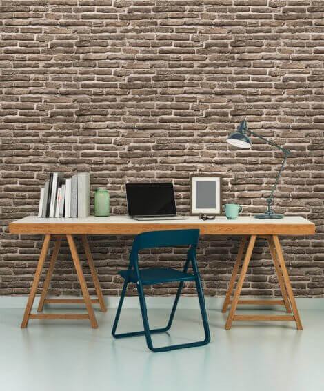 Brick wall with a sample table for a desk