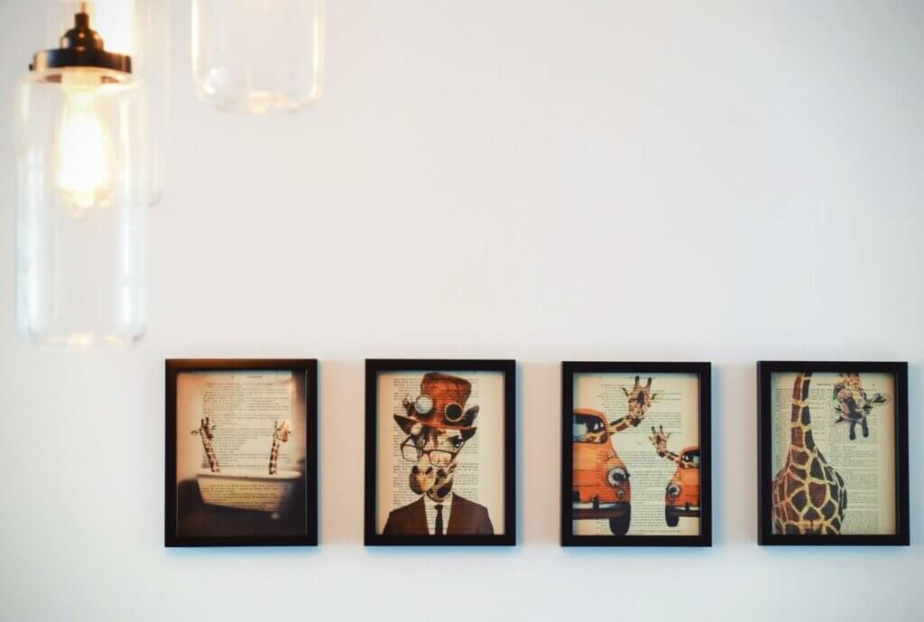 Four paintings on a wall.