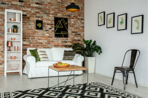 A living room with a brick wall which helps you have the industrial style in your home.