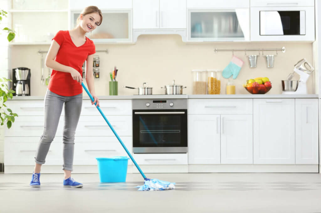 A woman cleaning her floor.