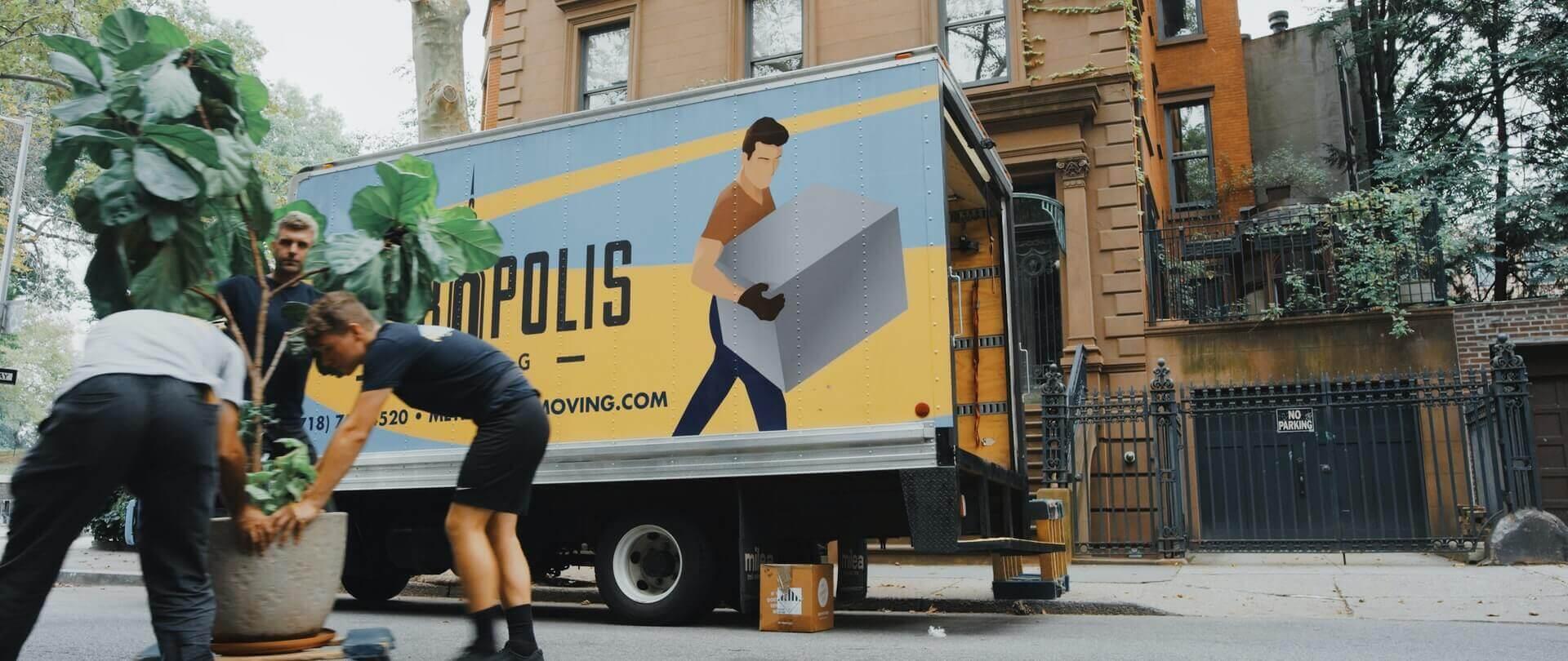 Movers unpacking their van.