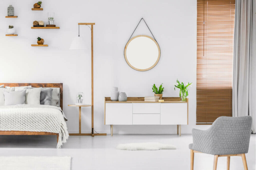 A white sideboard interior design in a bedroom.