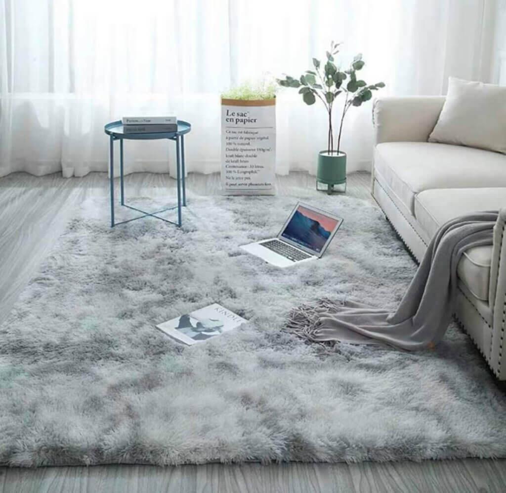 A gray shaggy rug.
