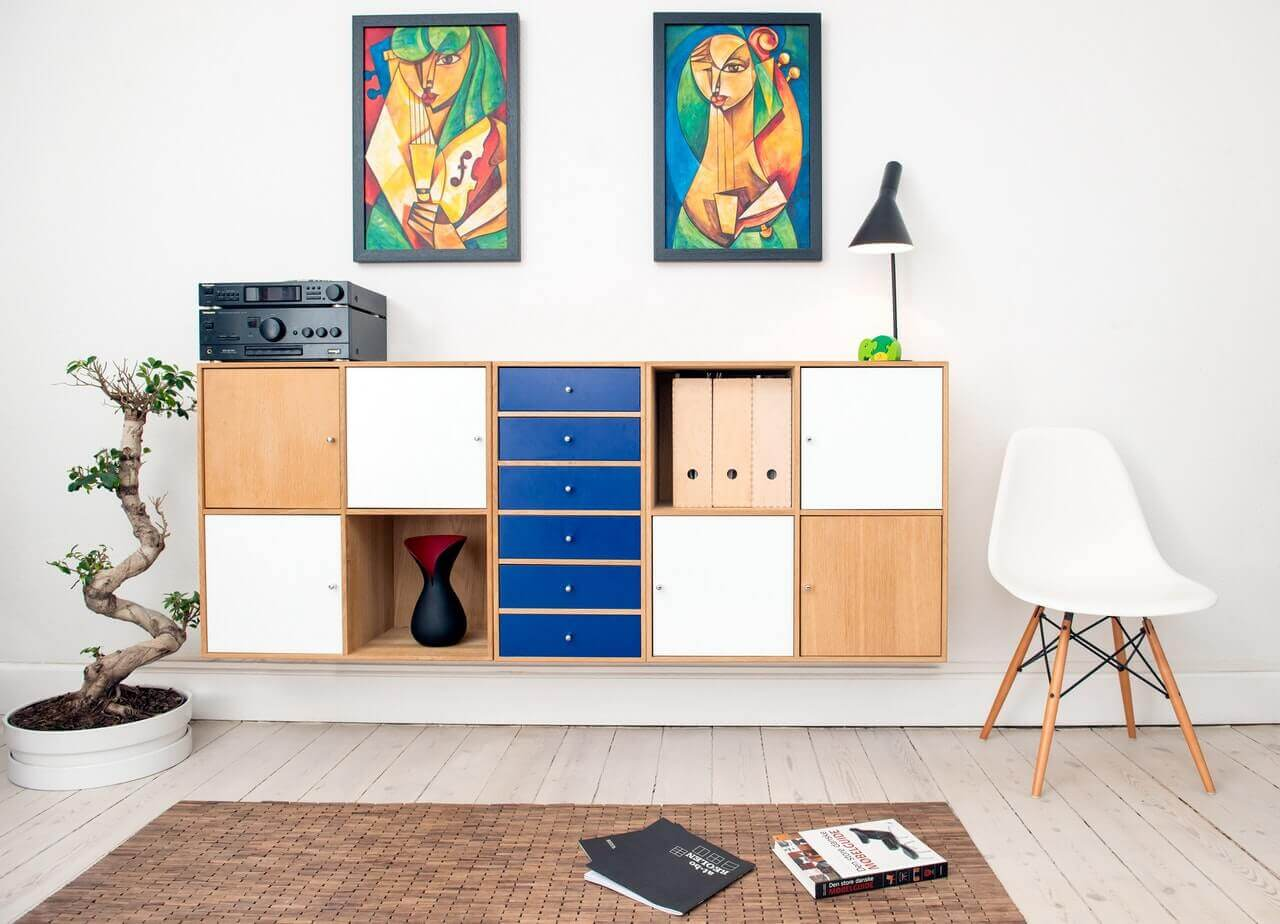 Decorate your walls with different types of paintings to avoid having a dull home.