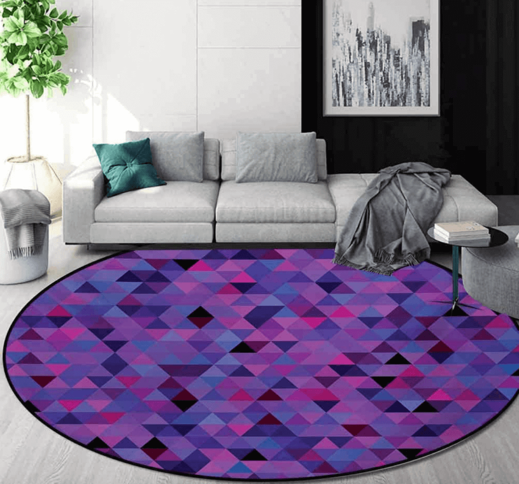 A gray living room with a purple rug.