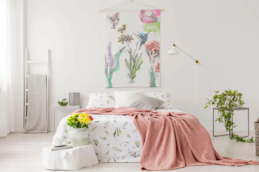 A bright bedroom in pastel shades.