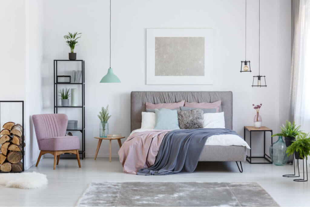 Different kinds of nightstand: a bedroom in pastel shades.