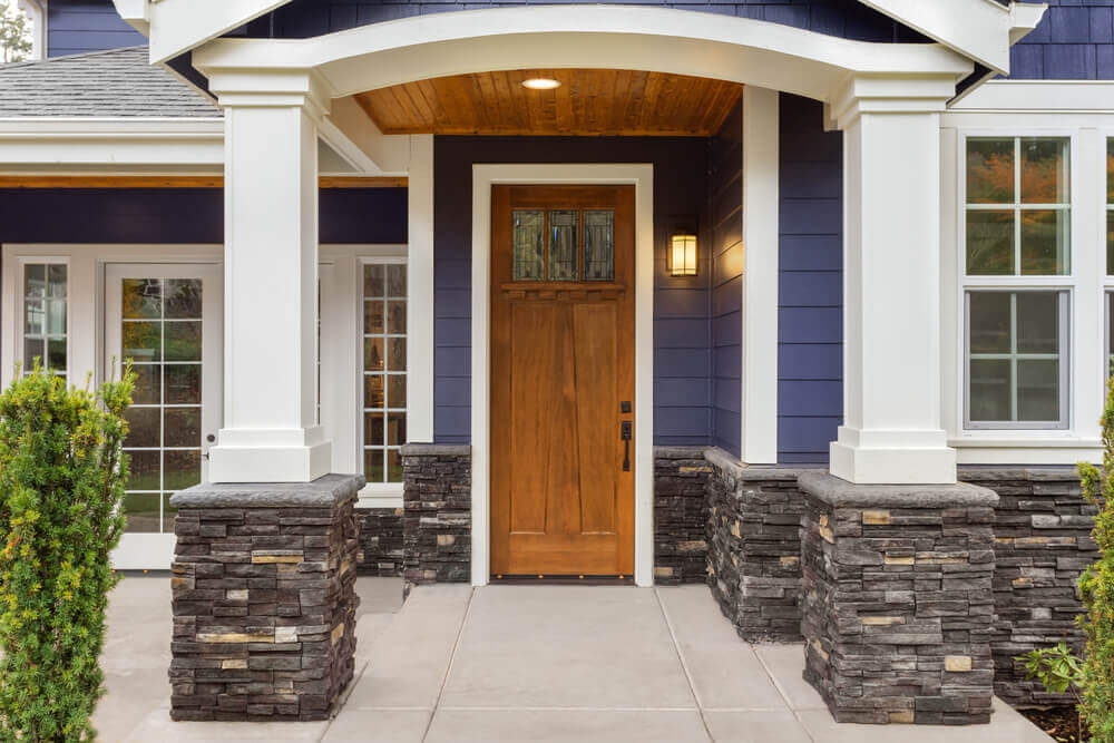 A house porch with columns and arches.