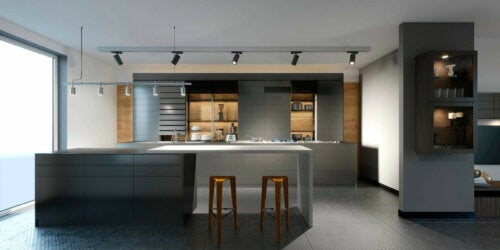 A modern kitchen with low lighting.